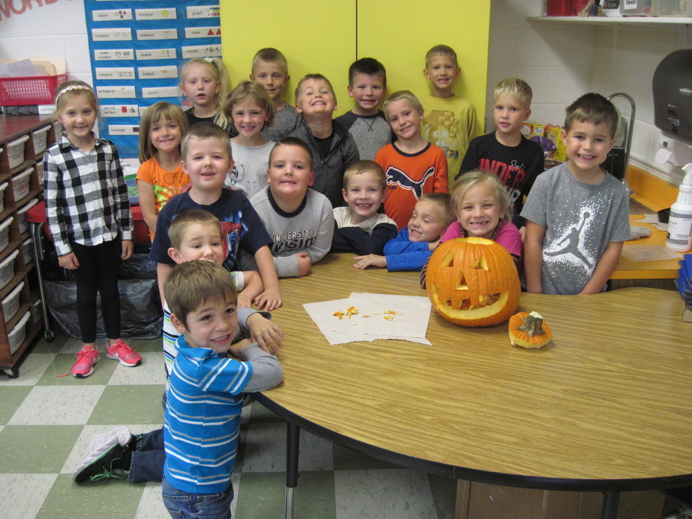 Mrs. Jansen's Kindergarten Class Sizes Up Their Pumpkin